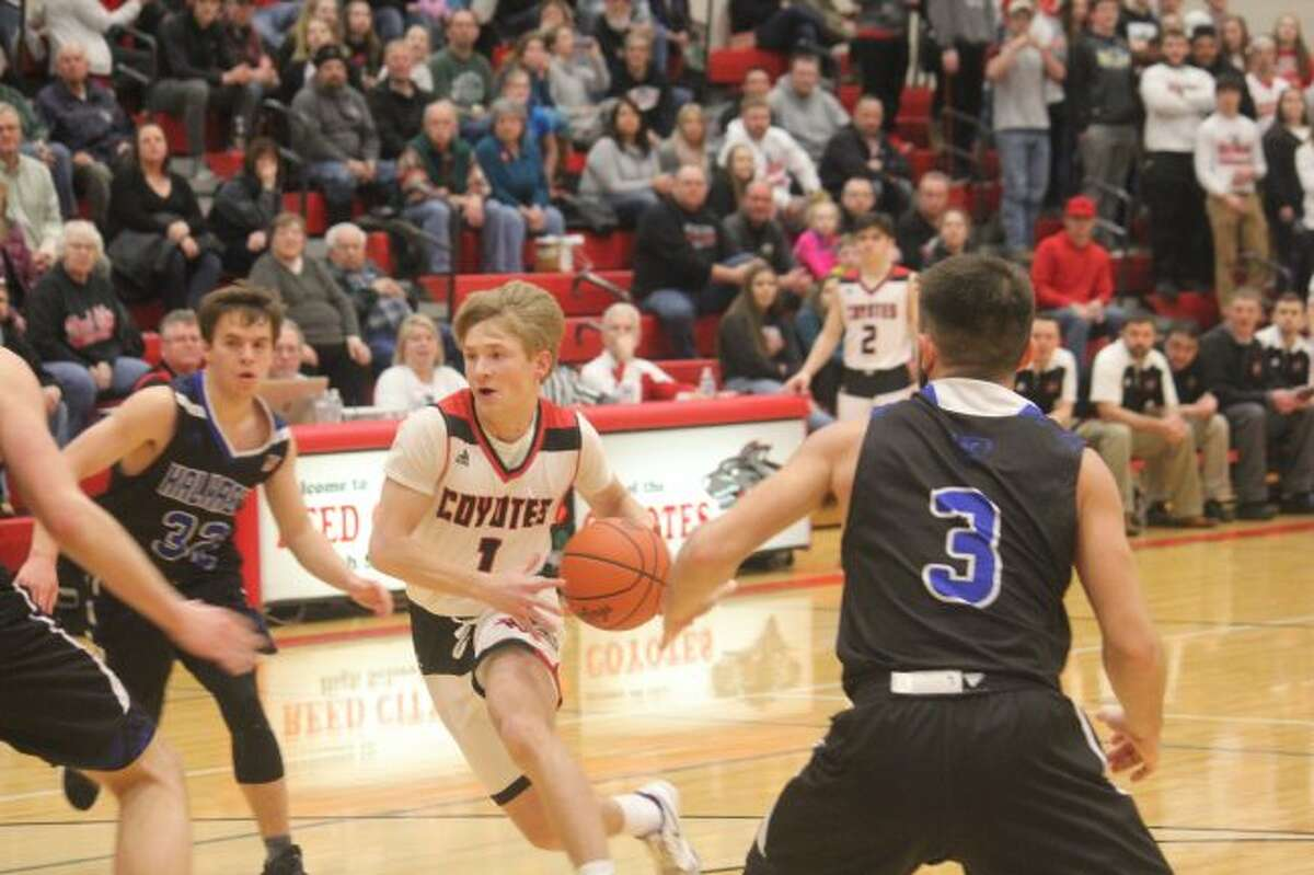 Reed CIty's Jackson Price heads to the basket.