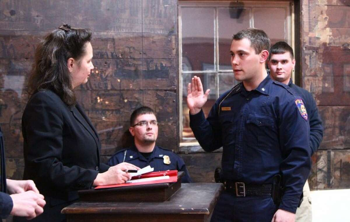 NEW RECRUITS: Timothy James Keena II swears into the Evart Police Department at the city council meeting on Feb. 2. He, along with fellow reserve officer Ryan Douglas, have officially joined the force and will assist this summer with general duties, holiday events and more.