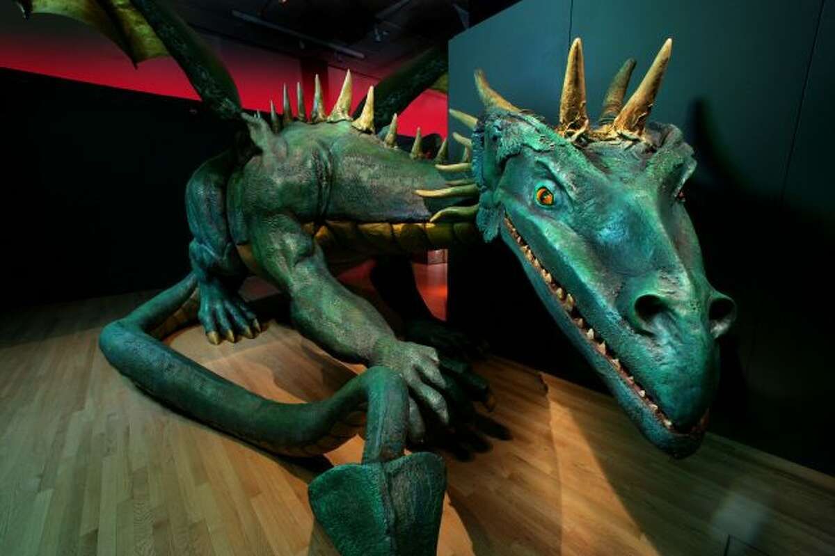 """A large model dragon watches visitors at the Grand Rapids Public Museum. The model is a part of the """"Dragons, Unicorns and Mermaids"""" exhibit currently on display at the museum, which is open from 9 a.m. to 5 p.m. Mondays through Fridays and 10 a.m. to 5 p.m. Saturdays and Sundays. (Courtesy photo)"""