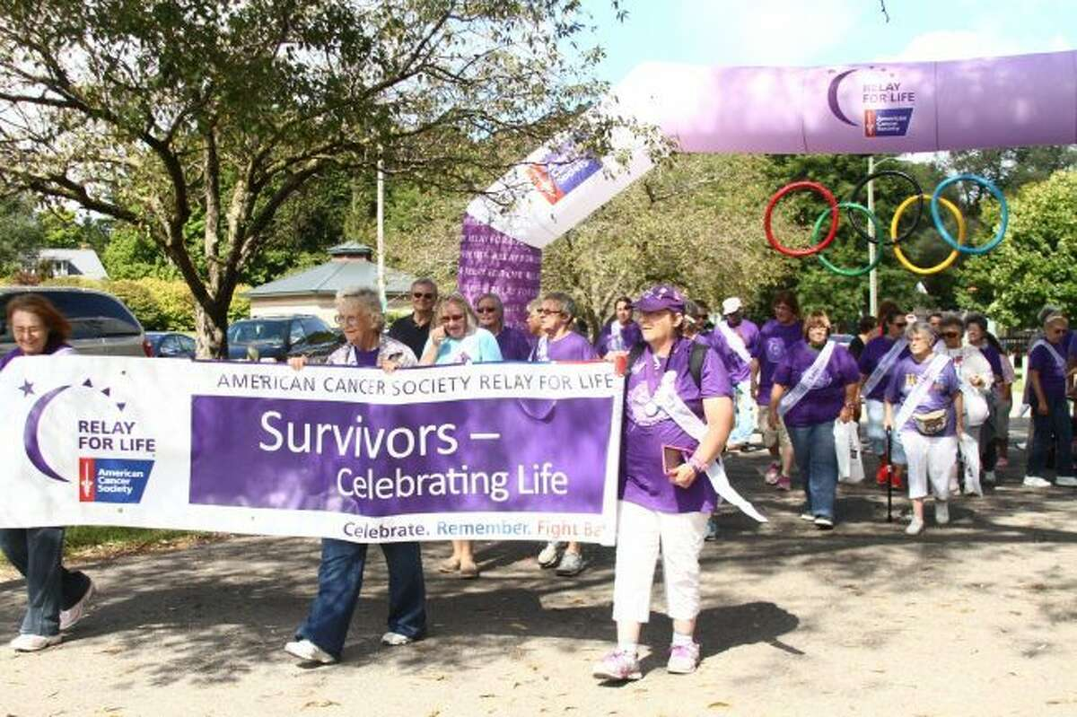 Cancer survivors begin the 2016 Relay for Life in Mecosta County's Hemlock Park. The 2018 walk is set to begin at 6 p.m. on Friday, March 23, at Ferris State University's Wink Arena. (Herald Review file photo)