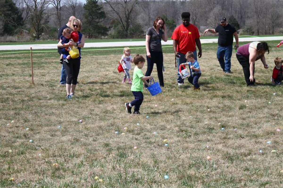 Children look for eggs during the Easter Egg Hunt last year at Roben-Hood Airport.