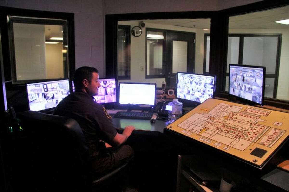 Mecosta County Jail Corrections Officer Shane Lyons mans the control center, watching monitors throughout the facility.