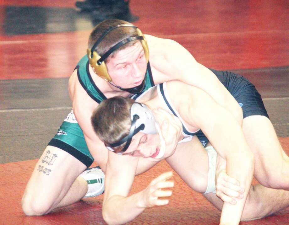 CONFERENCE: Kyle Nixon (left) of Pine River works on Tanner Kuipers of West Ottawa in Saturday's Reed City Invitational. (Herald Review photo/John Raffel)