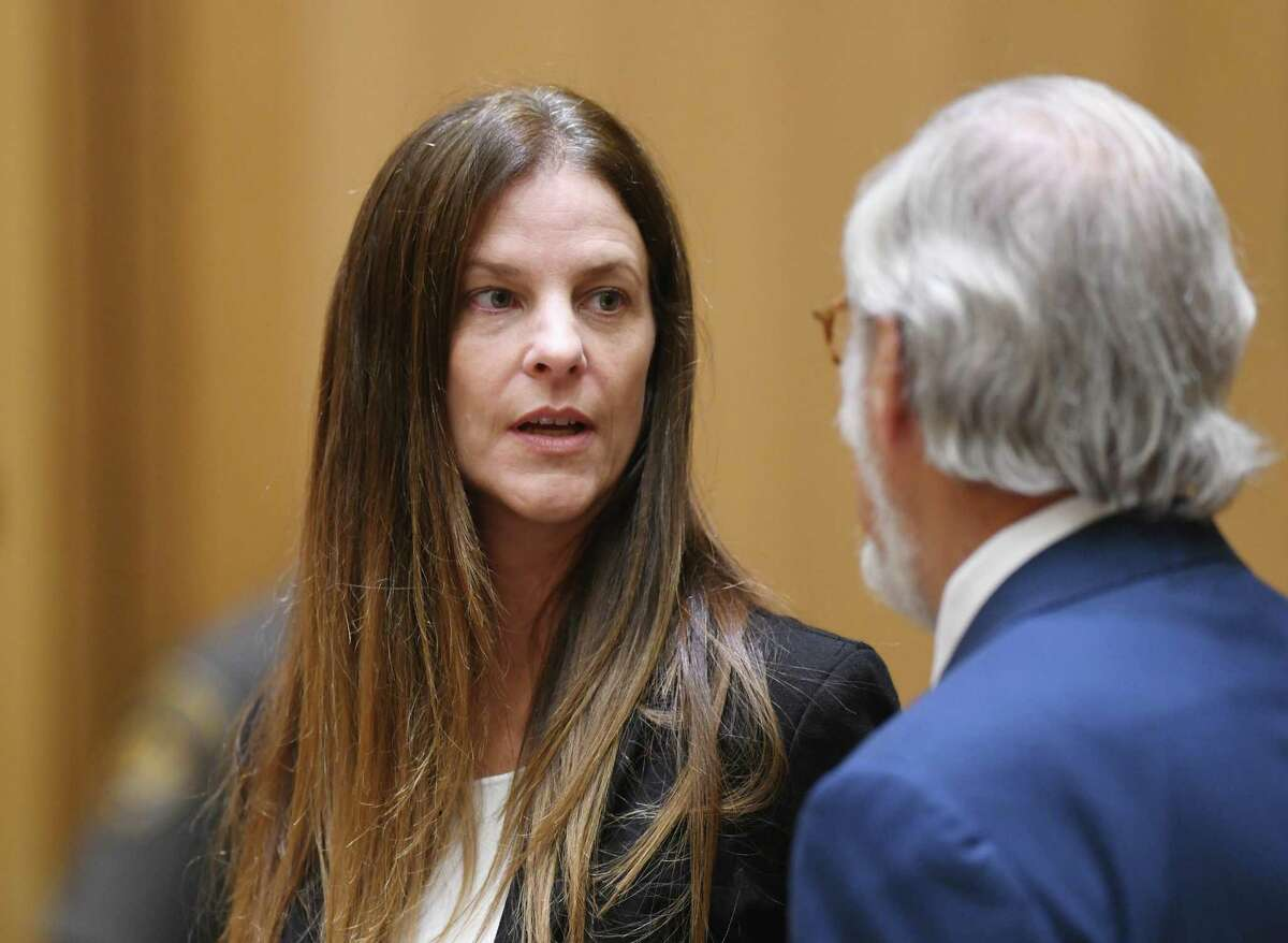 Michelle C. Troconis, 44, appears in court with her attorney Andrew Bowman in relation to her charges of tampering with or fabricating physical evidence and first-degree hindering prosecution, to which she has pleaded not guilty, at Connecticut Superior Court in Stamford, Conn. Monday, Aug. 19, 2019. The charges stem from video surveillance footage that police said shows two people resembling Troconis and Fotis Dulos making more than 30 stops in a four-mile stretch of Hartford the night of the disappearance of Dulos' wife, Jennifer. Police said the videos showed Fotis Dulos dumping bags that were later determined to contain clothing and cleaning supplies with his wife's blood, according to an arrest warrant.