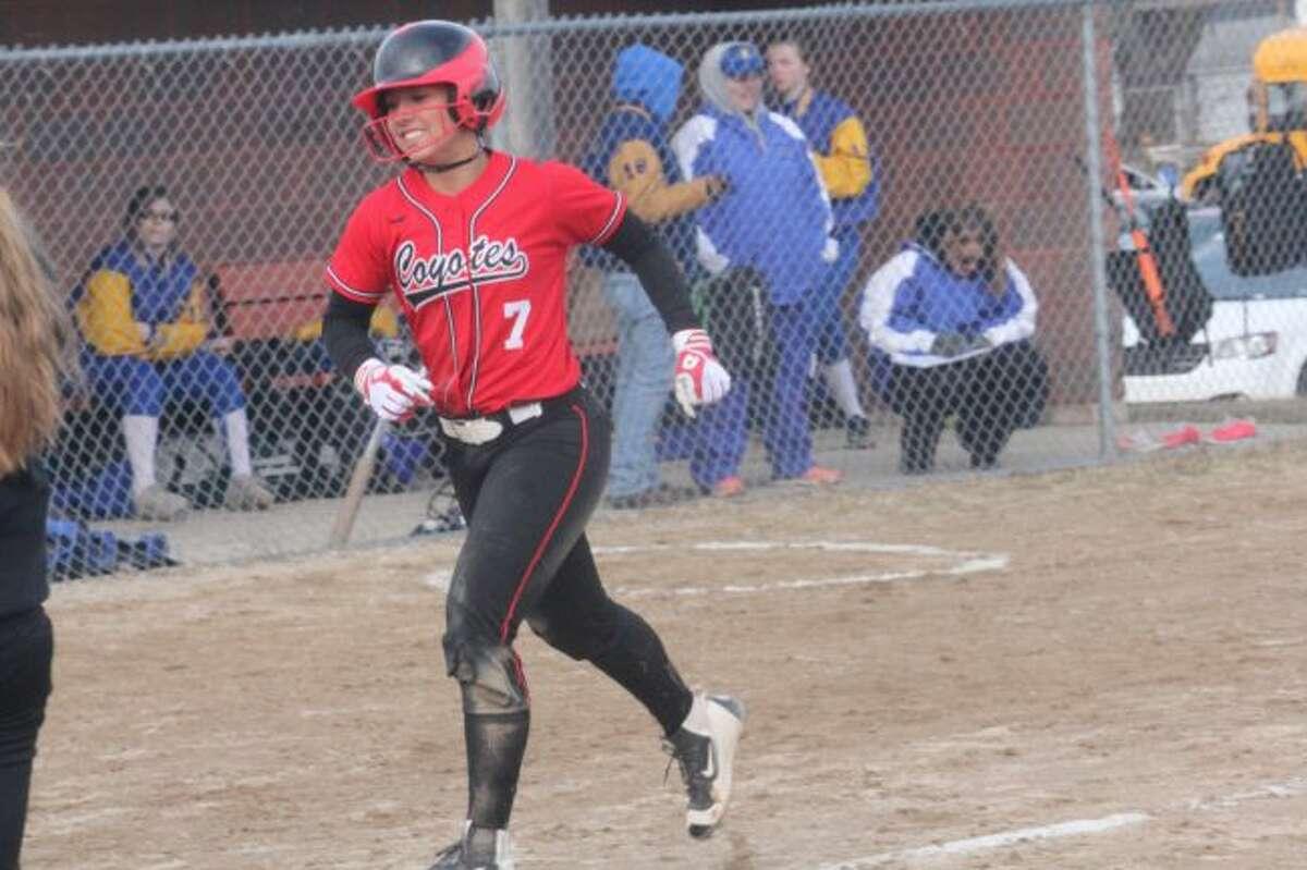Jordyn Storch celebrates her first home run of the season against Evart.