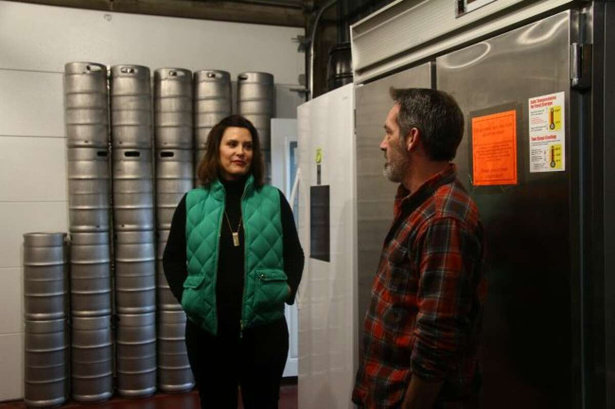Gretchen Whitmer, a democratic candidate for governor of Michigan, is given a tour by Kevin Murphy, owner of Reed City Brewing Company.