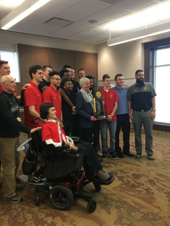 While at Ferris State University, Gov. Rick Snyder also presented a tribute to the Bulldogs basketball team, congratulating them on winning the NCAA Division II national championship. (Courtesy photo)