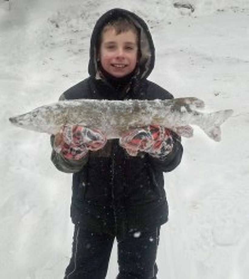 ICE FISHING: Bryce Shively shows off his 31-inch pike that he caught locally. (Courtesy phoo)