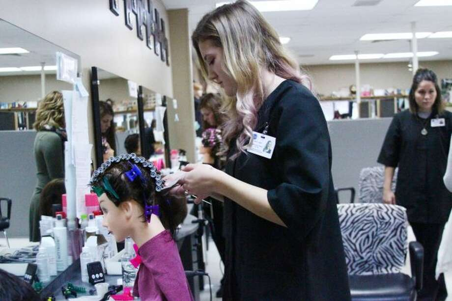 Mecosta-Osceola Career Center students practice on models while working in the school's salon. MOCC recently was granted accreditation for their cosmetology program, which may help students afford their courses if they return for their 13th year of study. (Herald Review file photo)