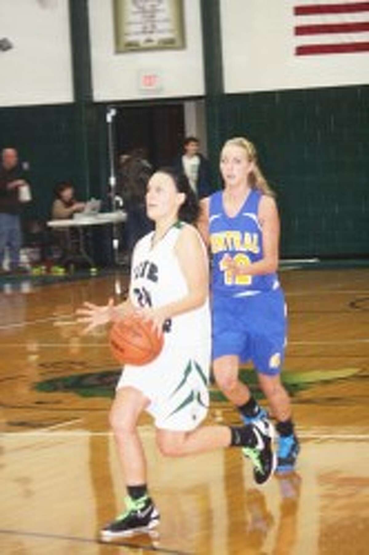 WINNING STREAK: Haley Raymond of Pine River takes the ball down the court. (Herald Review photos/John Raffel)