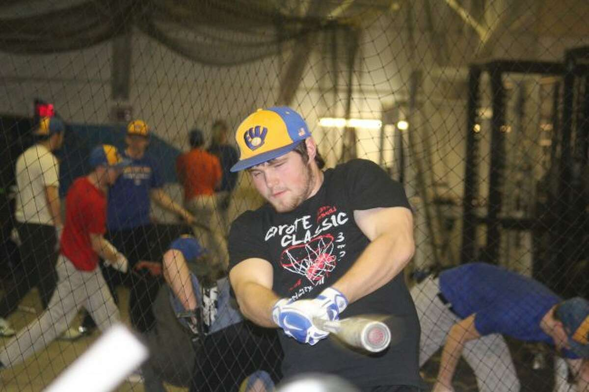Josh Dorn works on his swing.