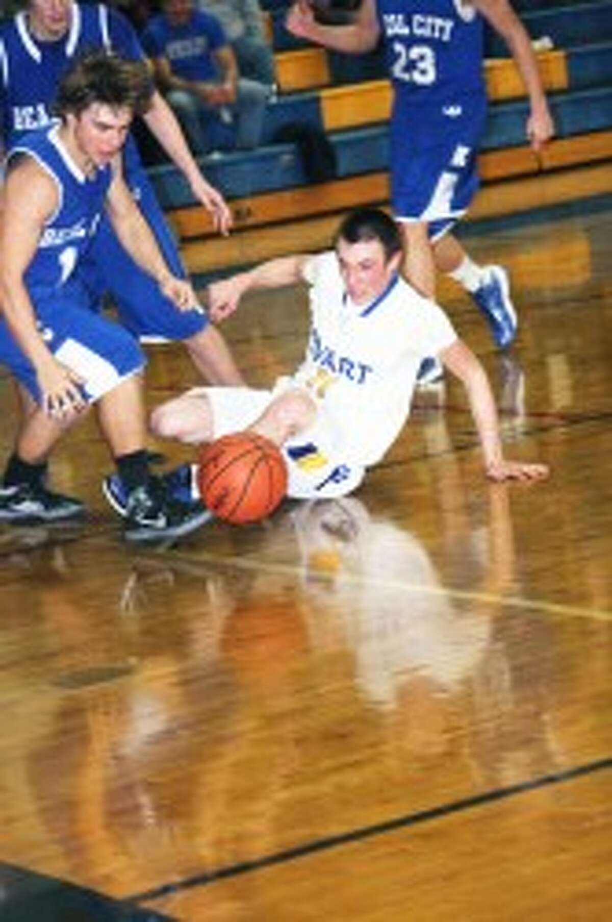 IMPRESSIVE WIN: Jared Pattee of Evart goes after the ball against Beal City. (Herald Review photo/John Raffel)