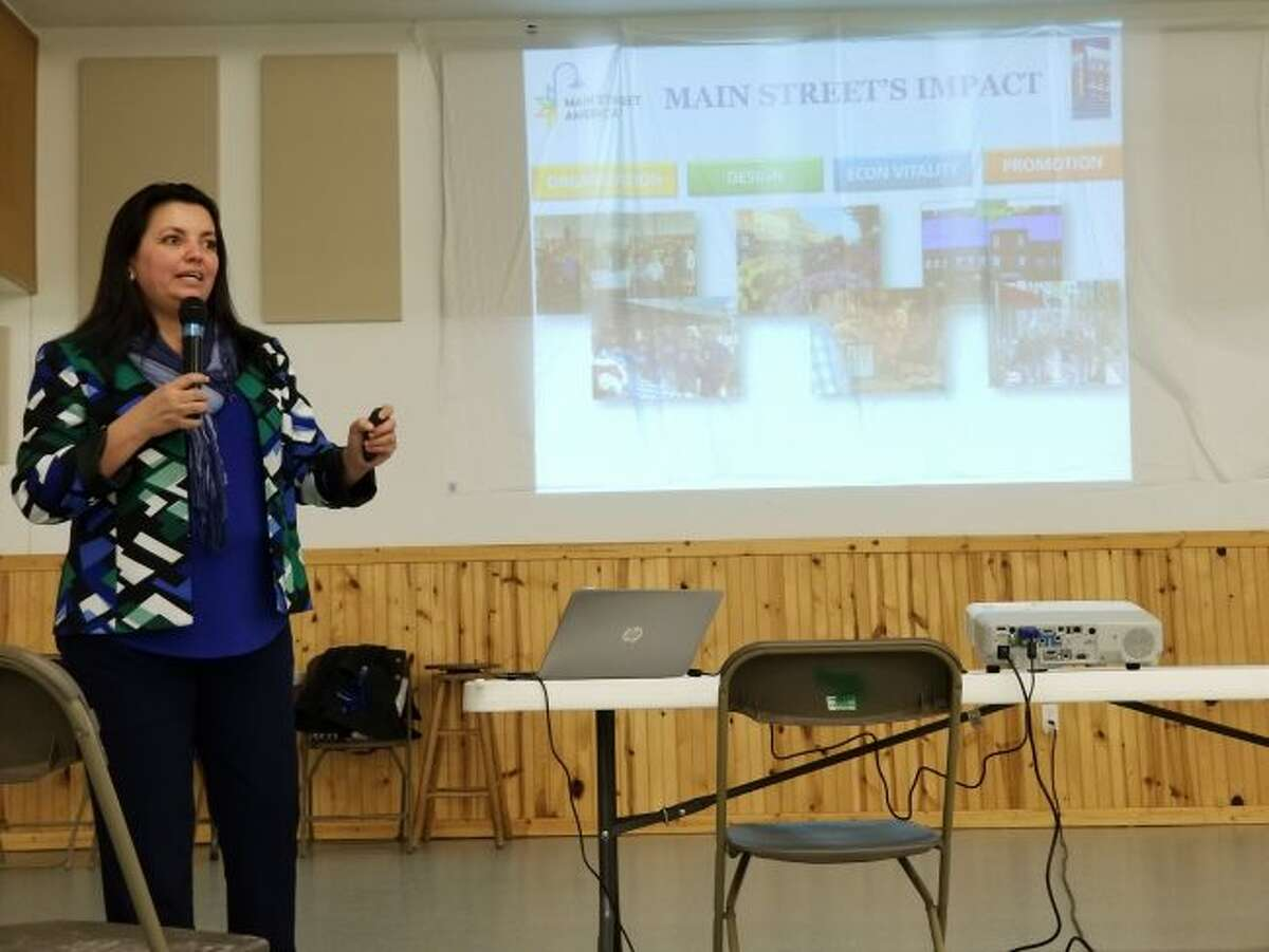 Norma Ramirez de Miess, National Main Street Center senior program officer and director of leadership development, presents the Main Street program to Evart community members during a kick-off event Wednesday, April 11, at the Osceola County 4-H/FFA Fairgrounds. (Herald Review photos/Meghan Gunther-Haas)