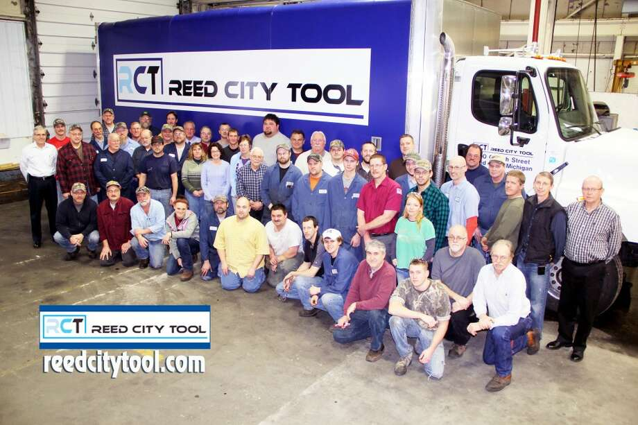EXPANSION: Reed City Tool employees pose near a brand new truck the company recently purchased to deliver its manufactured product. The company's steady increase in business has created 30 jobs in the past three years. (Courtesy photo/DW Video & Multimedia, LLC c2013)