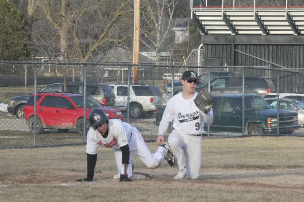 Reed City's Hunter Morrison is tagged out at third base.
