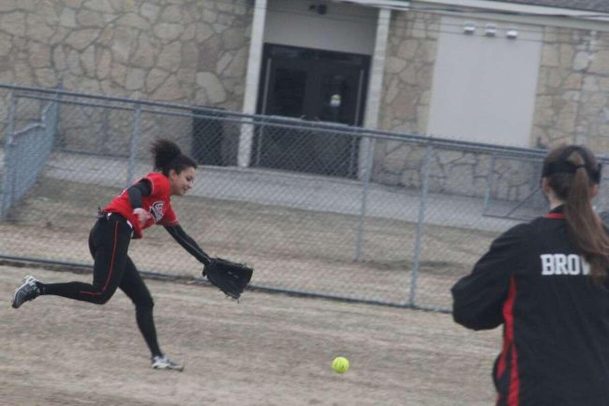 Kiera Barker chases down the ball against Kalkaska.