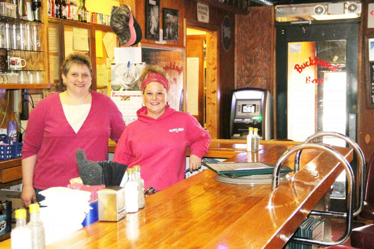 FRIENDLY FACES: Buckboard Bar and Grille employee Sally Glover and manager Mary Eva Smith. (Herald Review photos/Sarah Neubecker)