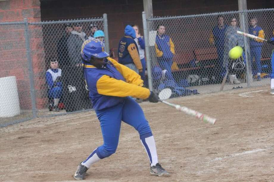 Cyana Dellar connects with a pitch.