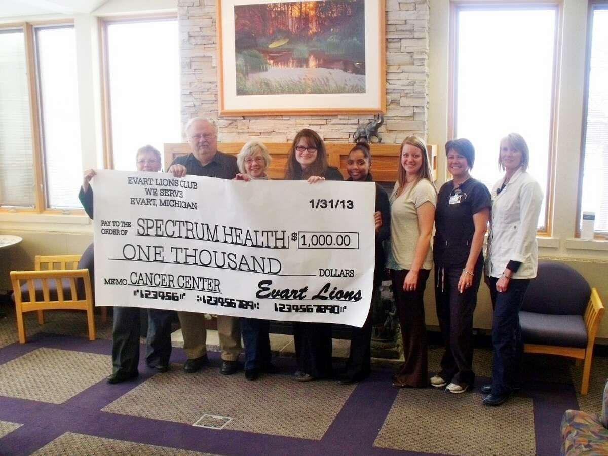 THE CHECK: Irene Balowski, director of cancer services, accepts a donation from the Evart Lions Club representatives; Terese Whitten and Bill Wilder, Christie Carlson, development director, Ashley Williams, Ferris State University intern, Katelyn Johnson, Foundation assistant, Amy Bomay, radiation therapist and Sandra McGrath, RN.