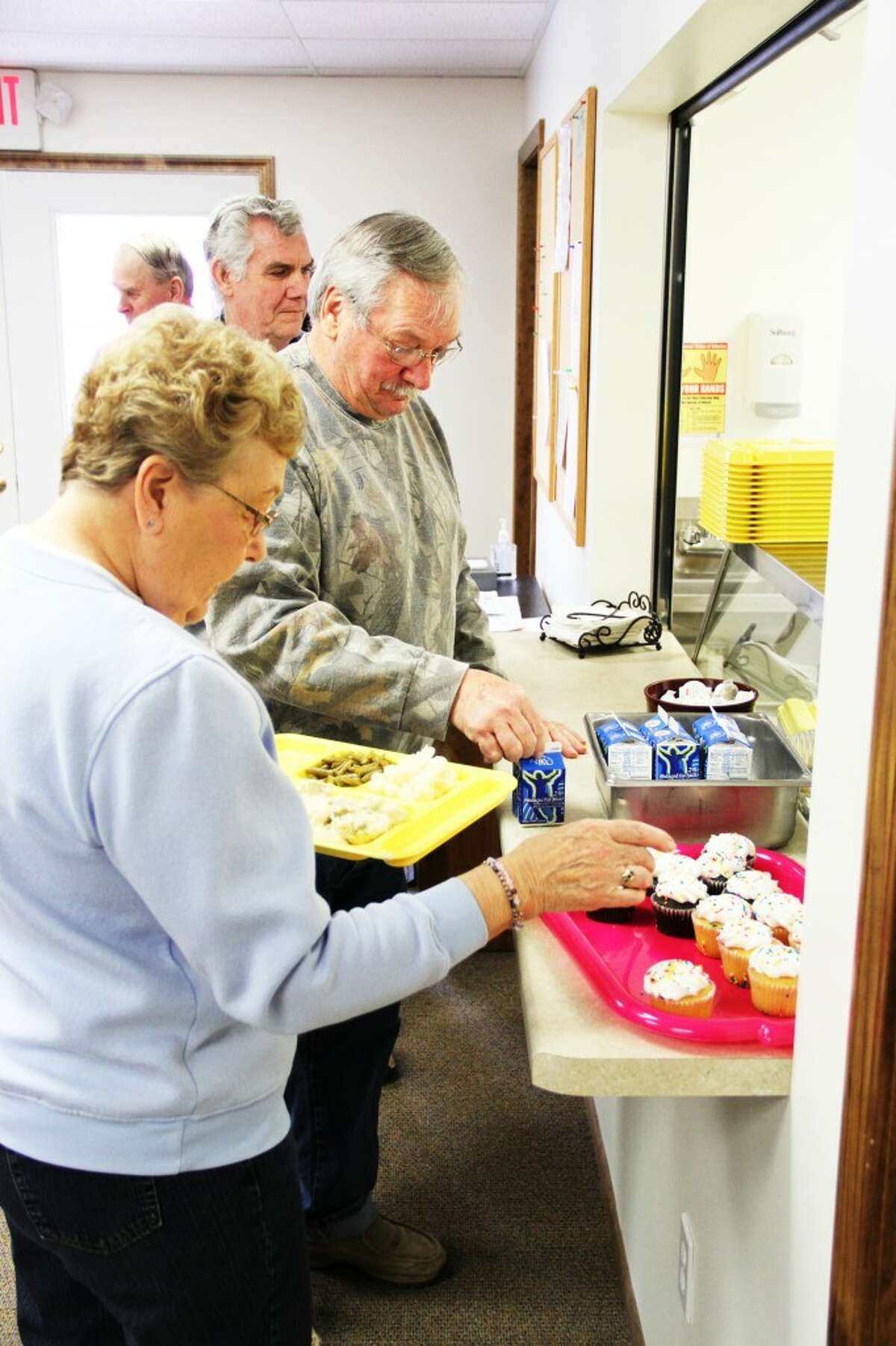 MORE INTERACTION: Staff and seniors are able to interact more with the meals program being held in a local location. (Herald Review photo/Sarah Neubecker)