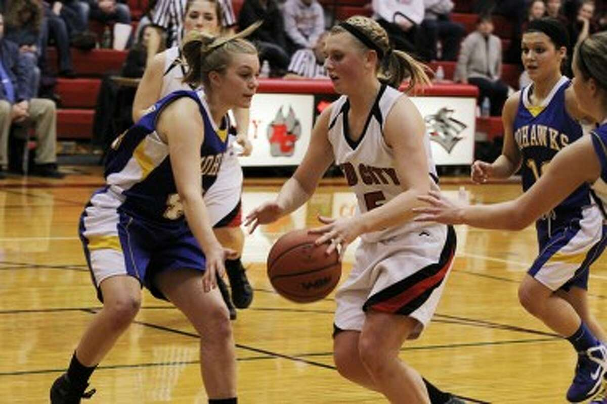 TO THE HOOP: Reed City's Makenzie Switzer take the ball to the basket on Wednesday against Morley Stanwood. (Pioneer photo/Martin Slagter)
