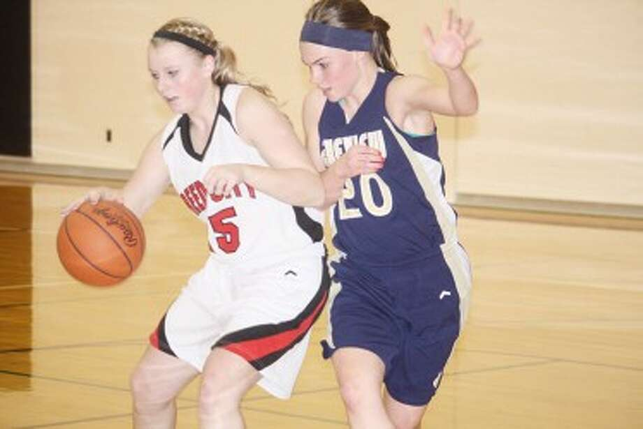 WATCH OUT: Reed City's Makenzie Switzer (left) tries to drive past a Lakeview defender during Friday's basketball action. (Pioneer photo/John Raffel)