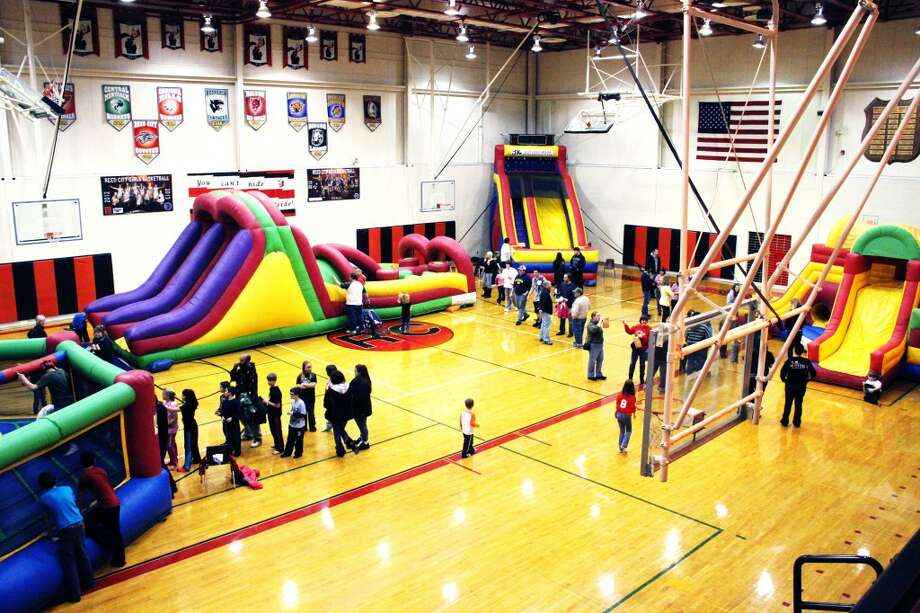 INFLATABLES: Sides, obstacle courses, and a boxing ring were all available during the 31st annual Reed City Band Carnival on Saturday. The bands were raising money for new uniforms. (Pioneer photos/Sarah Neubecker)