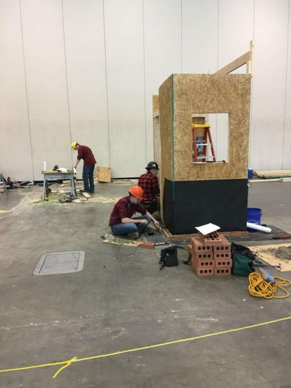 The MOCC construction team, consisting of Basil Beers, Nicholas McHugh, Tyler Schmitt and William Weinberg, competes during the SkillsUSA challenge. Overall, 16 MOCC students earned bronze, silver or gold medals. (Courtesy photo)