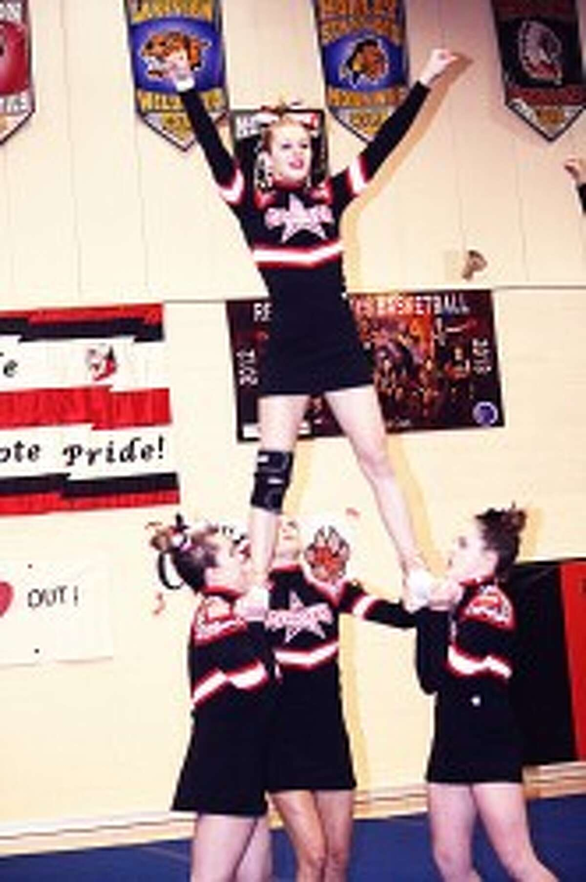 CHEER: Evart and Reed City cheer teams will be in the districts this weekend along with Pine River. (File photos)