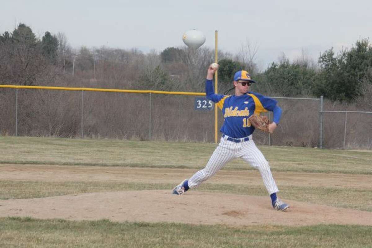 Evart's Parker Henry throws a pitch.