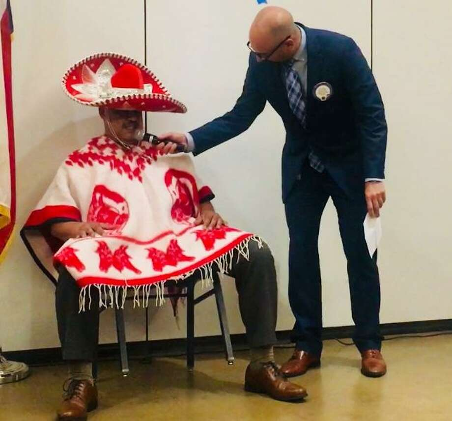 Recently VP Steve Williams disturbs the siesta of VP Ralph Perez to get more details about the Conroe Noon Lions Club's upcoming annual Dinner/Dance & Auction scheduled for Sept. 12 which this year will have a Latin flair. Photo: Courtesy Photo