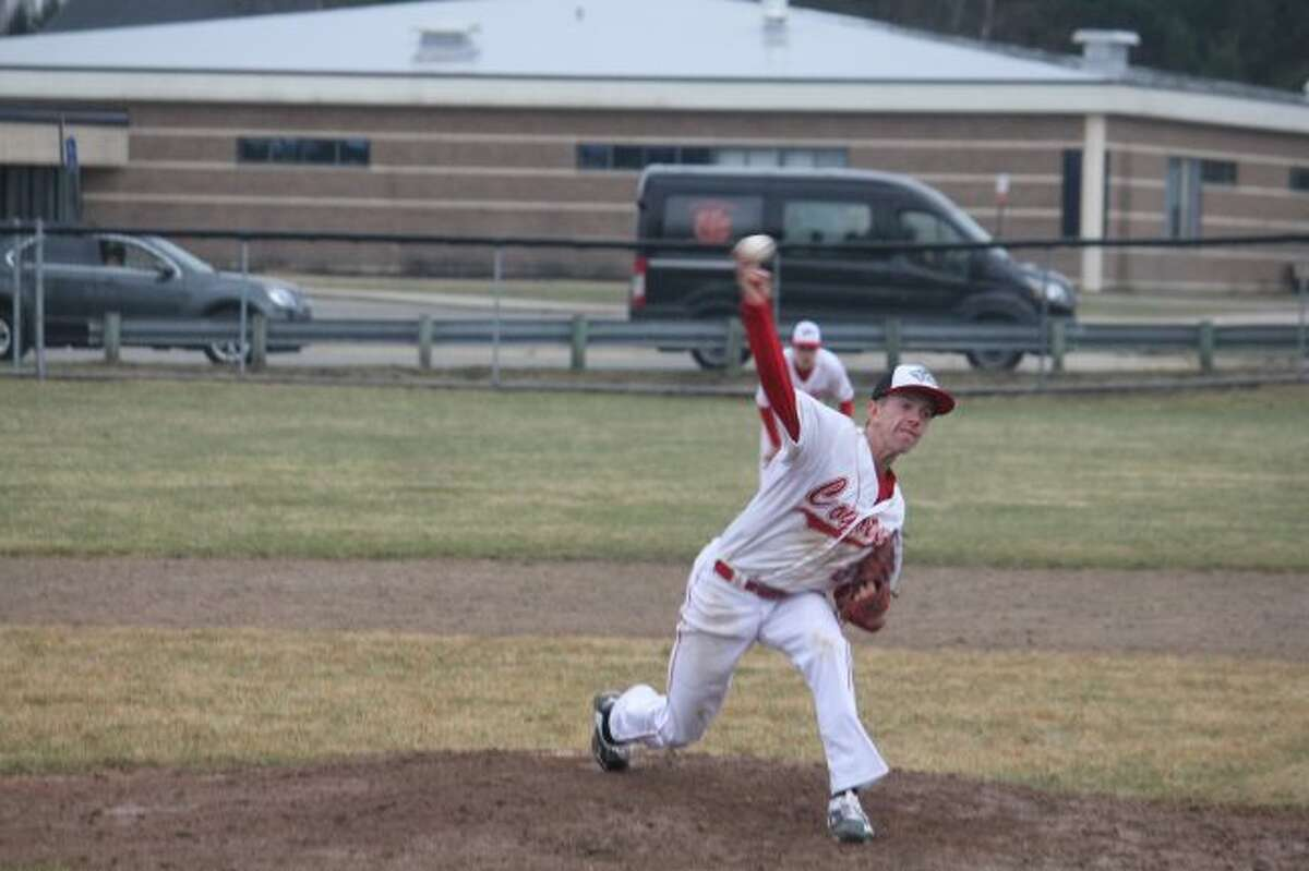 Reed City's Hunter Morrison fires a pitch to the plate.
