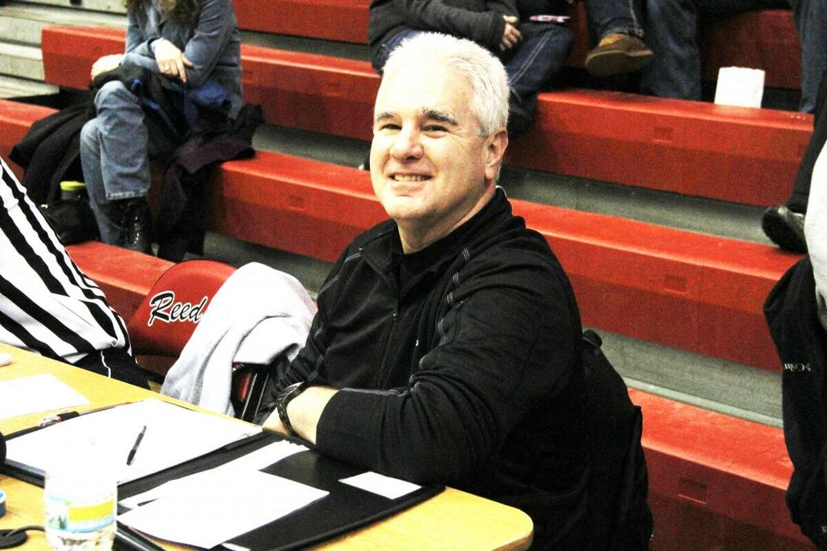 TELLING YOU THE SCORE: John Williams has announced Reed City sporting events for 41 years. When he isn't in the announcers chair, Williams spends his time selling water-treatment equipment and plumbing supplies as a co-owner of D&E Supply Company in Reed City. (Herald Review photo/Martin Slagter)