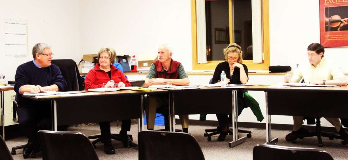 SCHOOL BOARD: Evart school board members consider the future of a building that is no longer in use. (Sarah Neubecker/Herald Review photo)