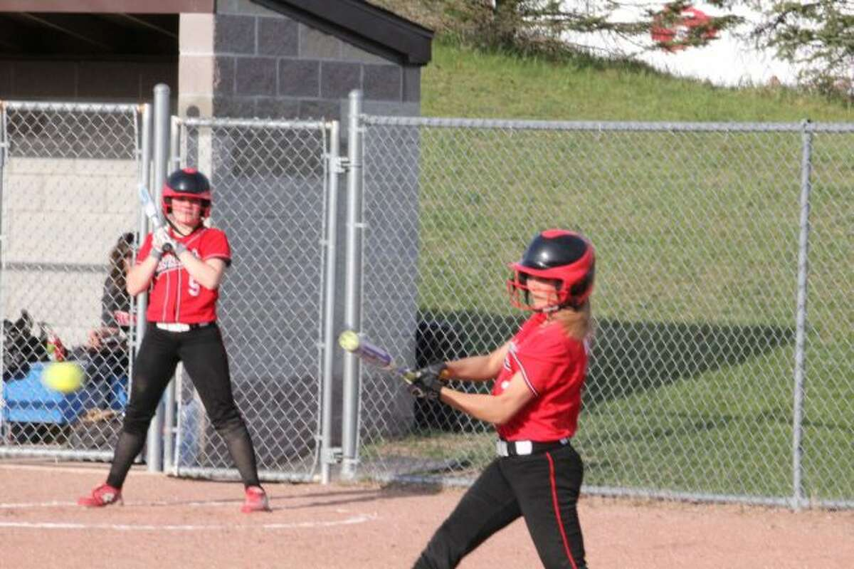 Kamryn Myers connects on a pitch for Reed City.