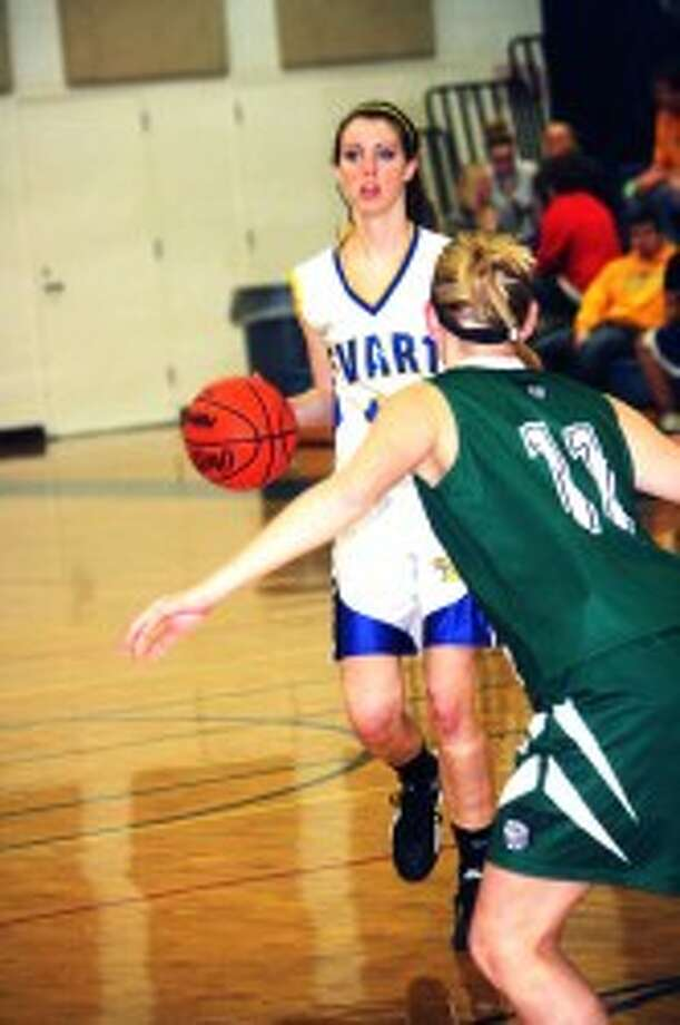 MAKING THEIR MOVE: Mara VanOrder looks to make a move against the Pine River defense. (Herald Review photo/John Raffel)