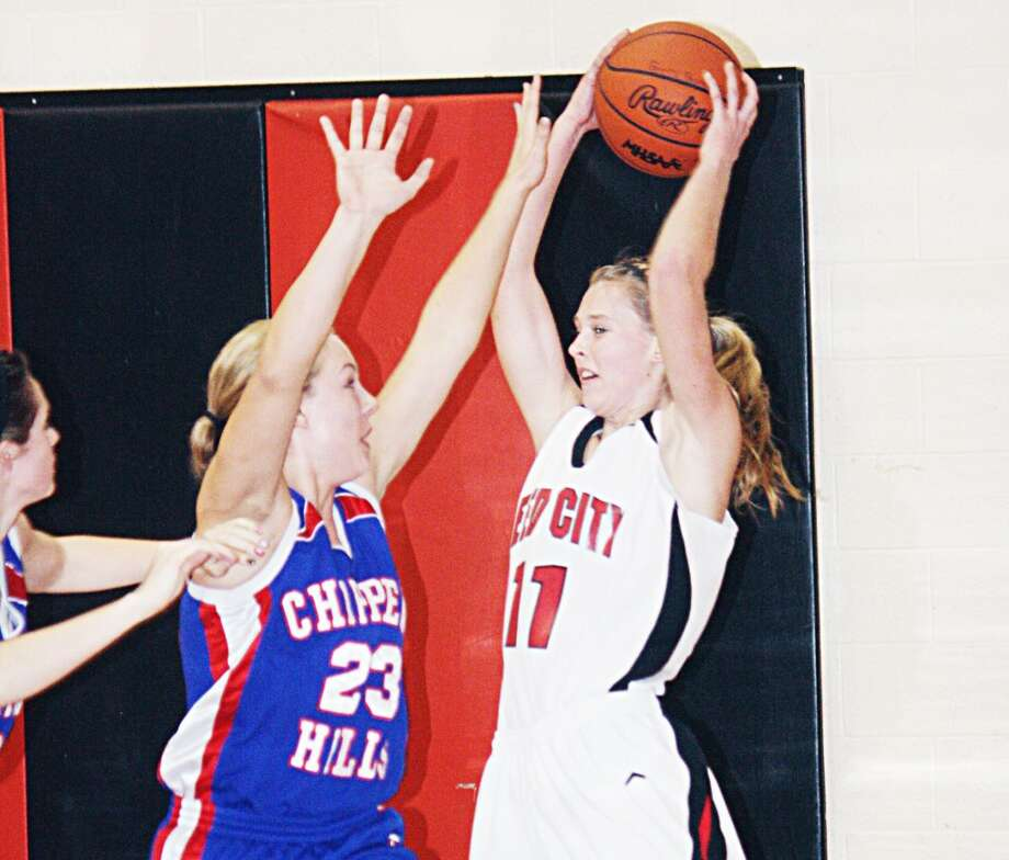 VICTORY: Natalie Westoff (11) of Reed City tries to keep the ball away from Chippewa Hills' Teagan Denslow. (Herald Review photo/John Raffel)