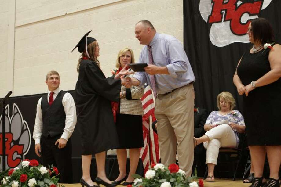 As each Reed City High School senior's name was called on Thursday night, they crossed the stage, collected their diplomas and shook hands with Superintendent Myra Munroe, members of the Reed City Area Public School Board of Education and school administrators during the 135th annual commencement ceremony. (Herald Review photos/Meghan Gunther-Haas)