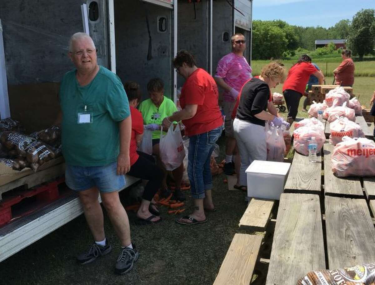 Volunteers unload the truck from Feeding America and prepare for distribution at a previous Barryton Area Mobile Food Pantry distribution. The first distribution this year will take place Saturday, June 9. (Courtesy photo)