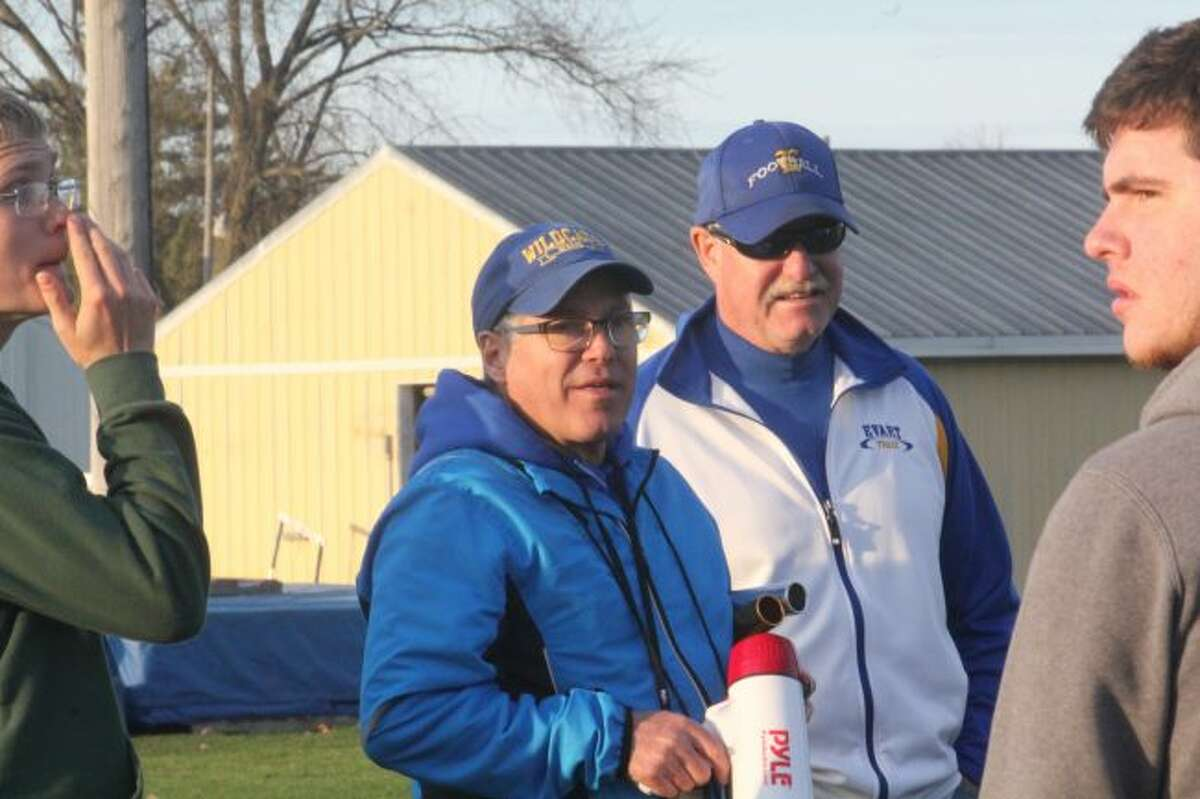 Coach Dennis Peacock talks with his team after a meet.