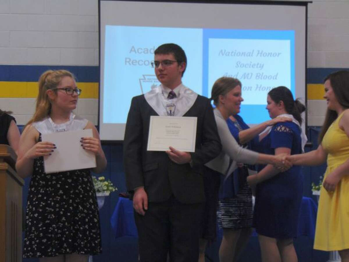 Evart High School seniors received their National Honor Society stoles during their awards night. Students also received various scholarships to help them cover the costs of college. (Herald Review photo/Shanna Avery)