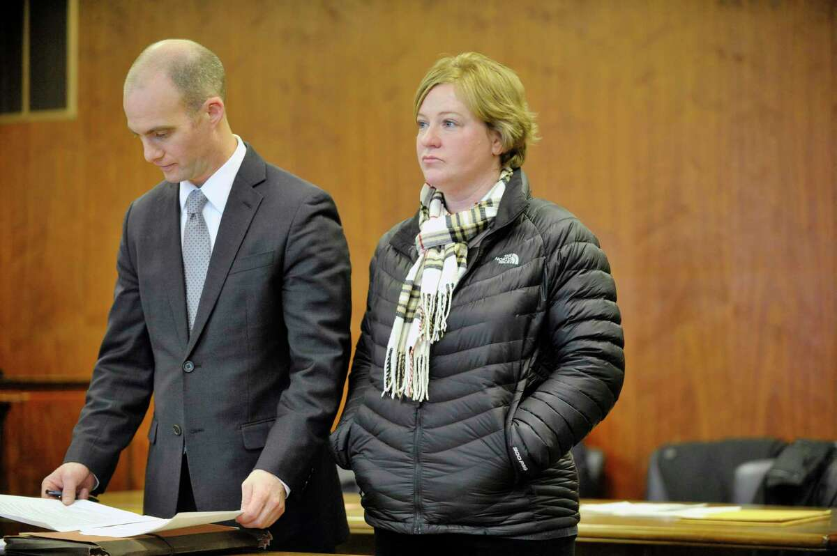Defense attorney James Knox, left, stands with his client Carrie LaFond in Schenectady County Court for LaFond's sentencing on Wednesday, Jan. 21, 2015, in Schenectady, N.Y. LaFonda was sentenced for stealing $466,000 from John D. Marcella and Son Appliances & Home Entertainment, where she was employed. (Paul Buckowski / Times Union)