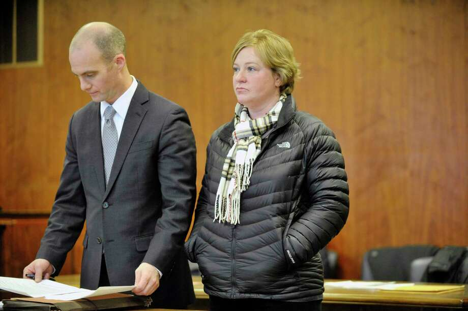 Defense attorney James Knox, left, stands with his client Carrie LaFond in Schenectady County Court for LaFond's sentencing on  Wednesday, Jan. 21, 2015, in Schenectady, N.Y.  LaFonda was sentenced for stealing $466,000 from John D. Marcella and Son Appliances & Home Entertainment, where she was employed.  (Paul Buckowski / Times Union) Photo: Paul Buckowski, Albany Times Union / 00030224A