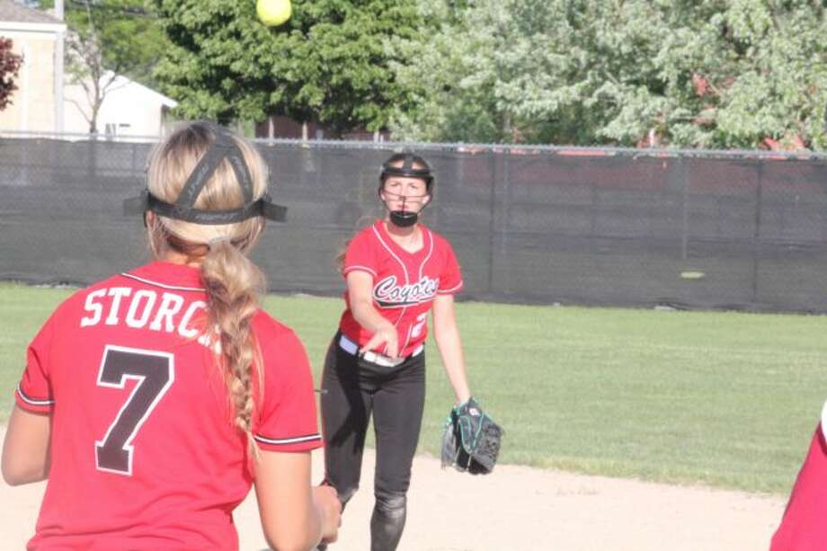 Madi Brown fires the ball to first baseman Jordyn Storch.