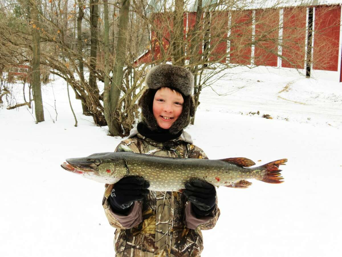 CATCH OF THE DAY: Luke Hill, of LeRoy, caught a 31.5 inch pike on a private lake in Tustin in January.