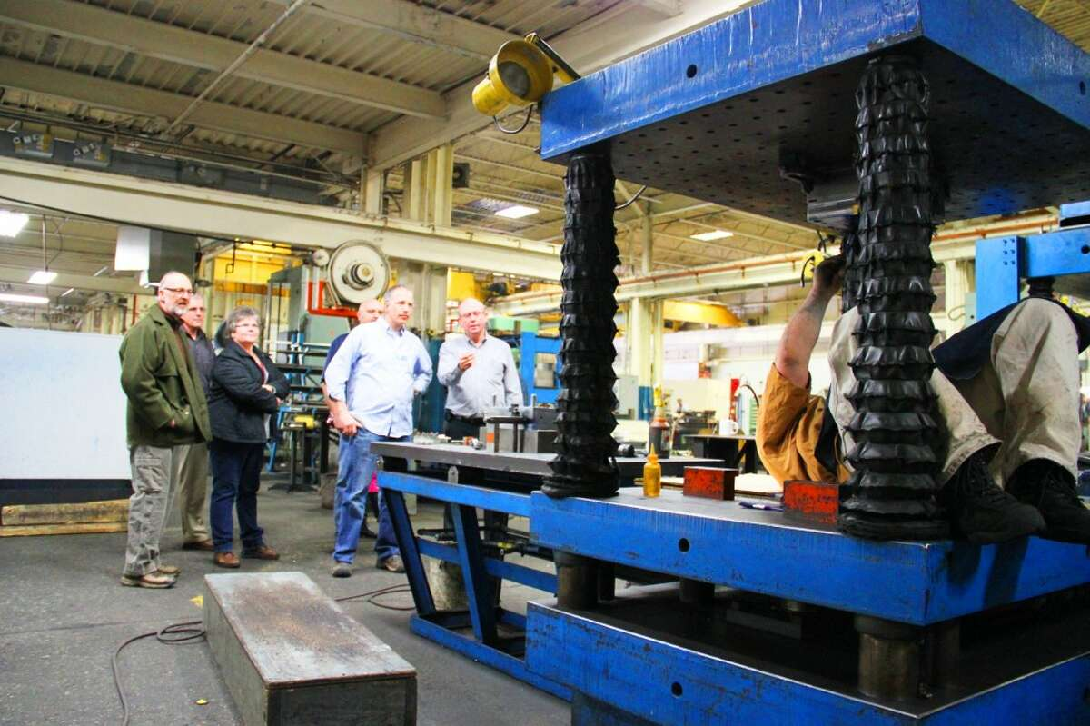 PLANT TOUR: Reed City Tool owner Rod Weck gives Osceola Leadership Summit participants a tour through the plant on Thursday as part of Economic Development Day. (Herald Review photos/Sarah Neubecker)