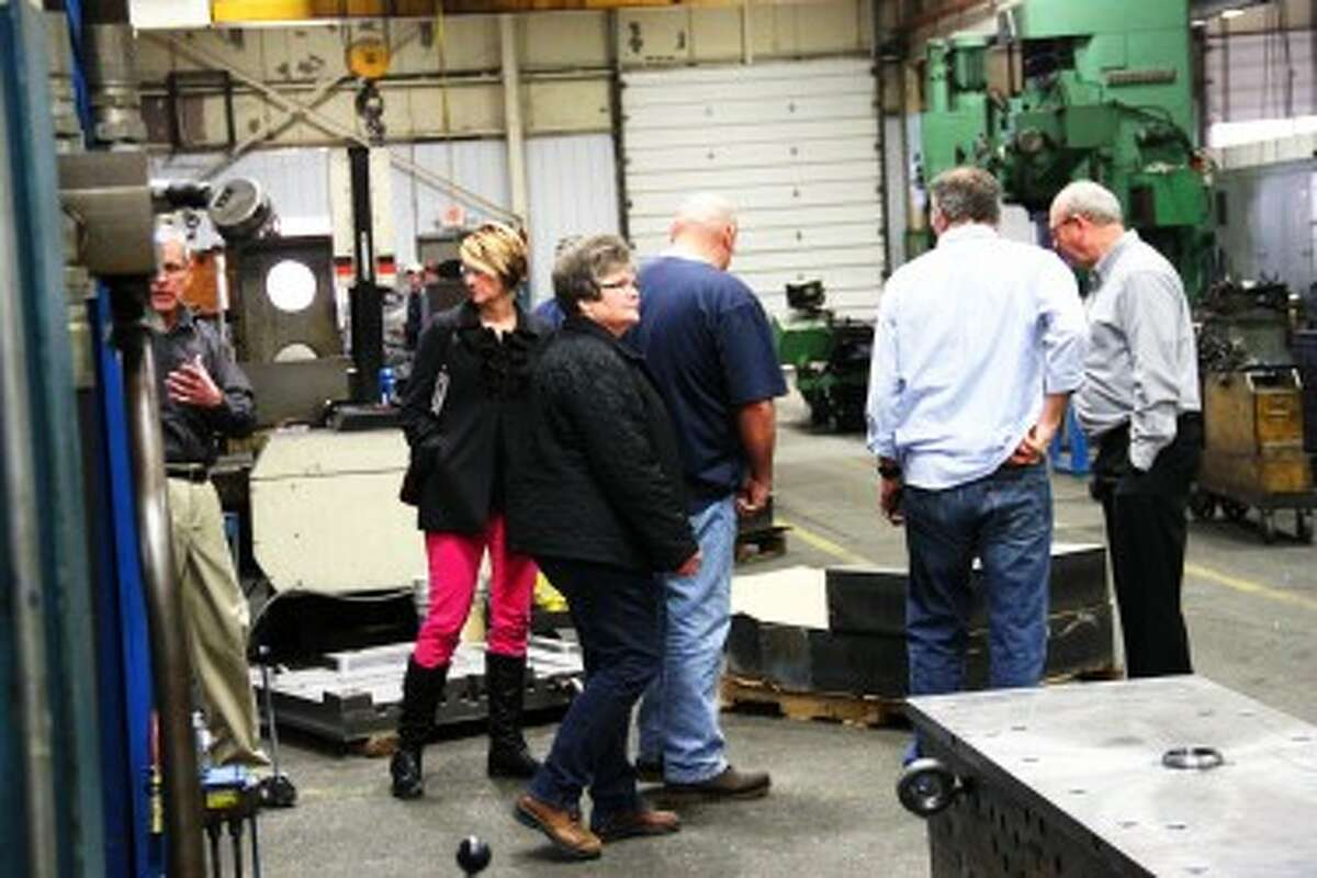 FIRST-HAND LOOK: Osceola Leadership Summit participants get a first-hand look at Reed City Tool, a business in Reed City that sells its items to companies all over the world.