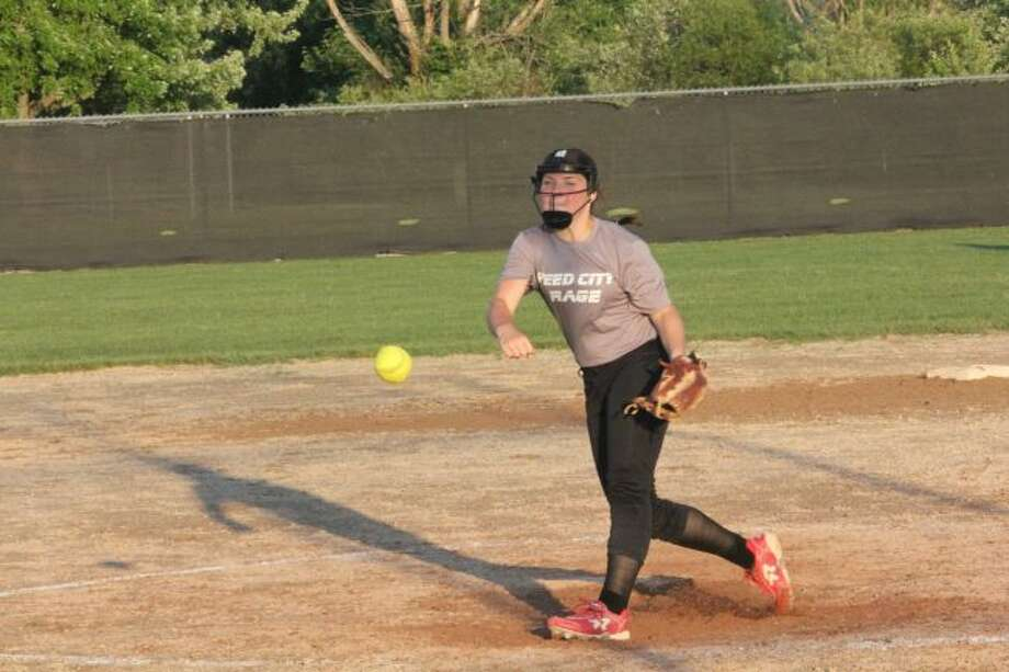 Reed City's Maddie Morgan delivers a pitch/