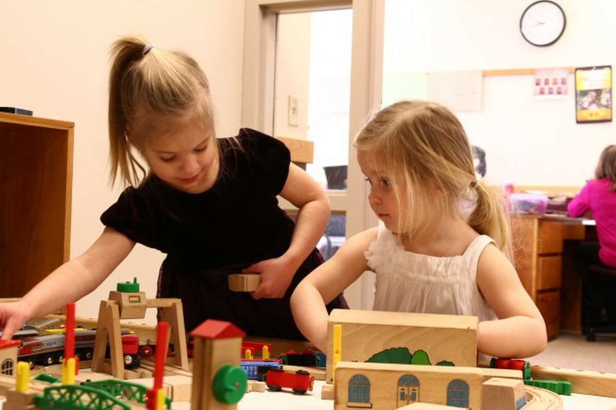 PLAYTIME: Fiona Rohde, 4, and Nellie Frederick, 3, take time to play with a train set at Trinity Lutheran School. Jessica Frederick, Nellie's mother, is planning on enrolling the child into preschool. Her older daughter, Taylor, already is a student at Trinity.