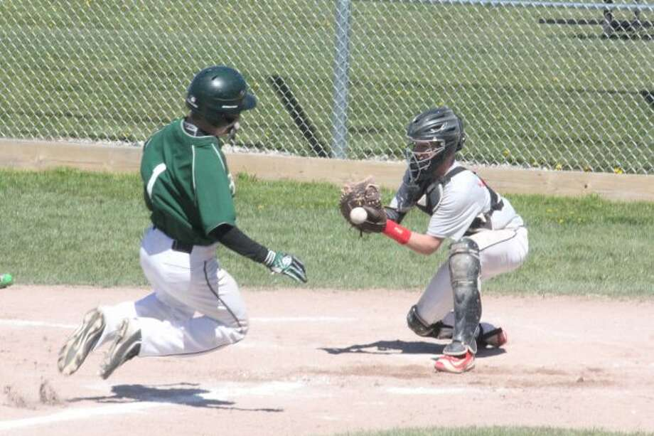 Pine RIver's Jacob Roberts gets set to slide safely into home plate
